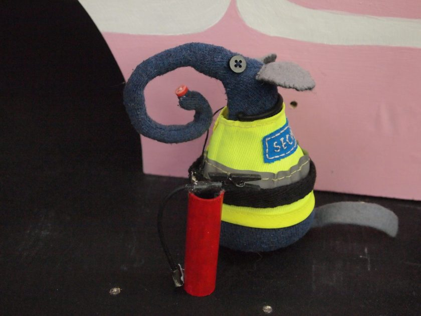 Ernest is at the side of the stage in the hi-vis vest with the fire extinguisher