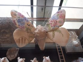A textile moth with embroidered wings