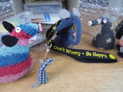 Ernest wears a lanyard that reads Don't worry, Be Happy.