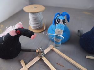 Arnold pulls a coil of wire off a reel