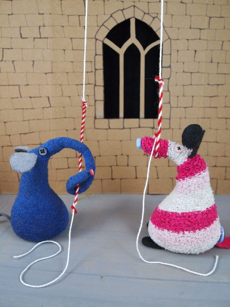 Ernest and Matilda are pulling on bell ropes in a churches