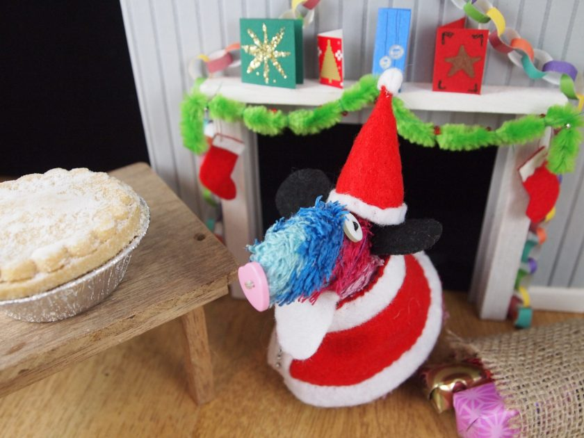 Ratvaark dressed as Santa emerges from a chimney to see a mince pie on the table