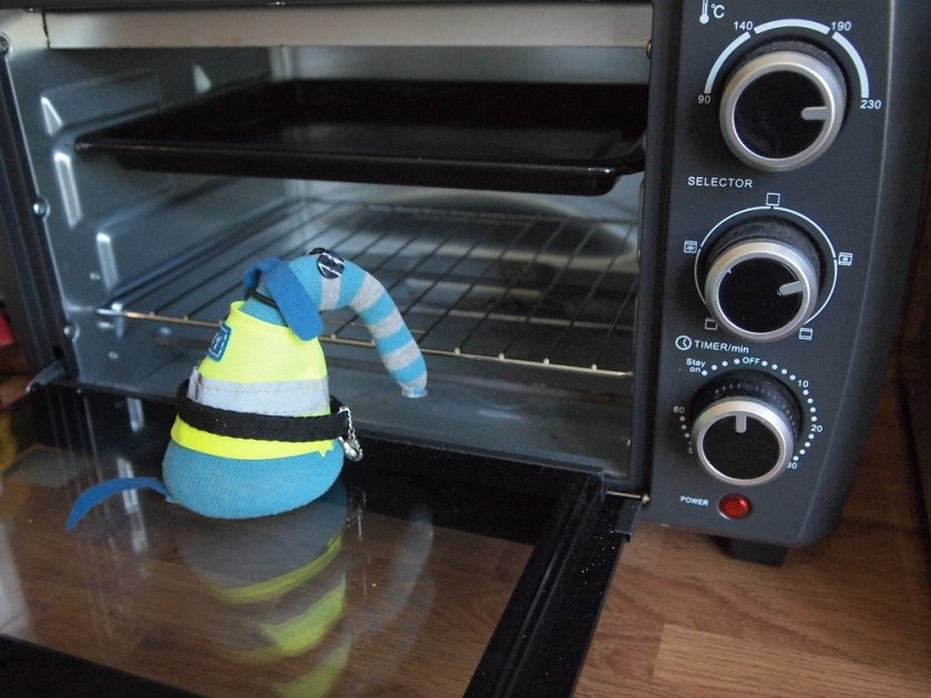 Arnold looks into the oven