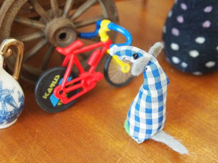 Micro looks at a bicycle next to the stall