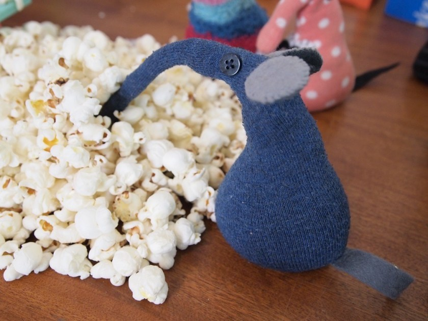 ernest reaches into the pile of popcorn with his long snozzle