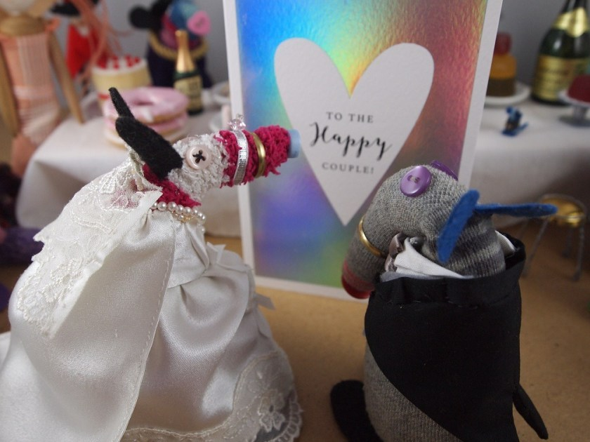 Dim and Matilda look at a wedding congratulations card