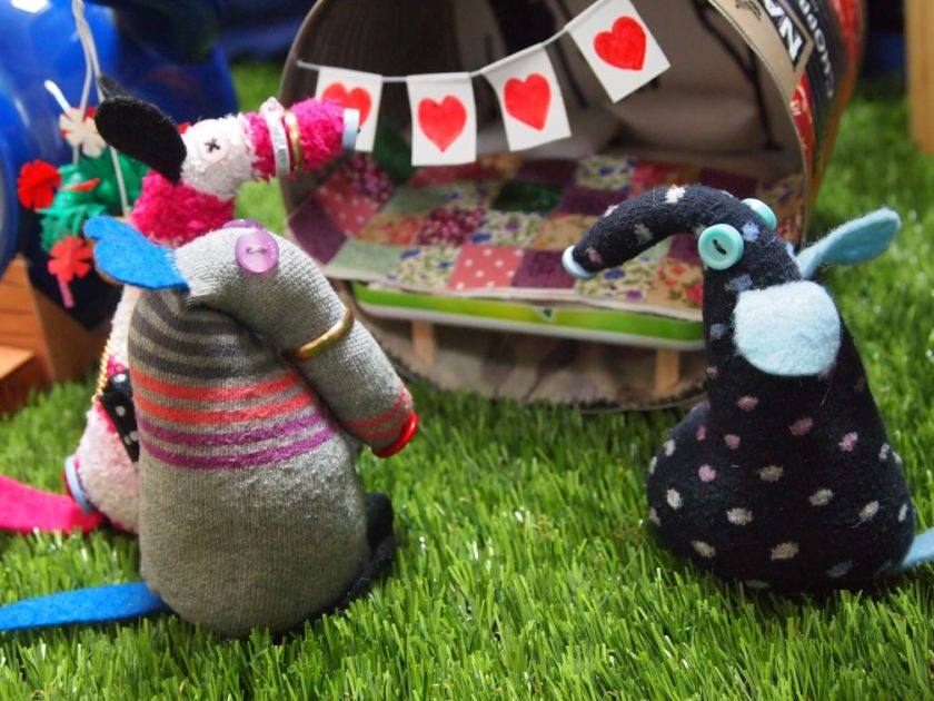 Dim and Matilda look at some bunting with hearts on hung on their glamping pod