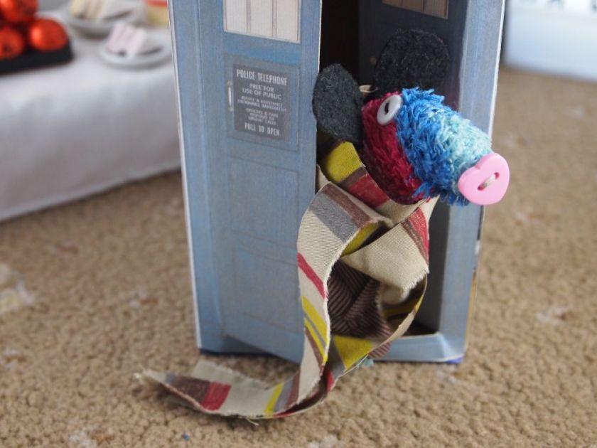 Ratvaark peers out of the open tardis door