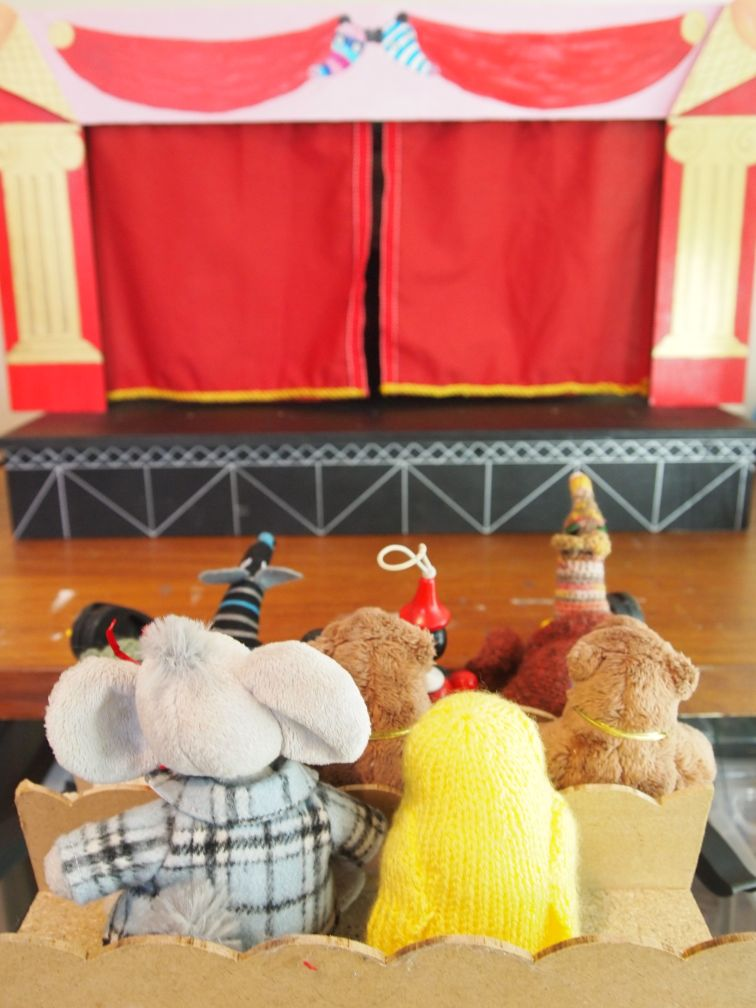 The vaark theatre is set up with an audience of vaarks and other small soft toys.