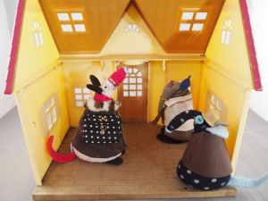 Inside the little house, Matilda and Dim look around the single room