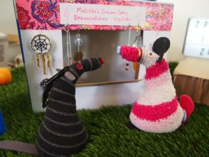 Matilda looks at her stall of dreamcatchers and crystals