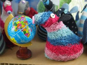 ratvaark poses with the globe