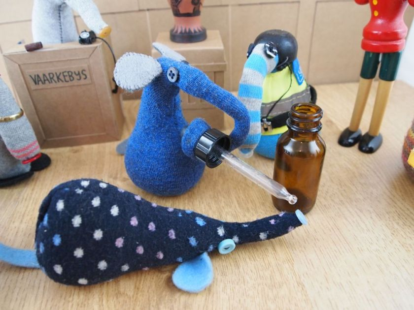 Ernest tries to revive Winston with something from a dropper bottle