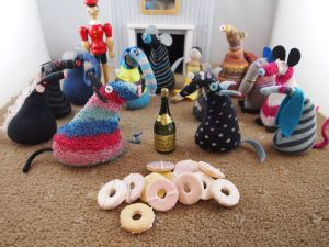 Back at home, the vaarks have a bottle of champagne and a pile of party ring biscuits