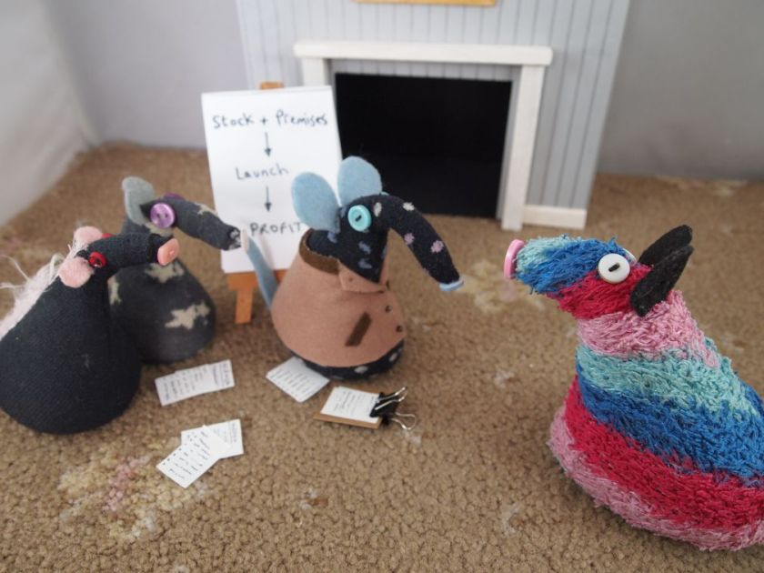 Ratvaark speaks to the three, who look at him