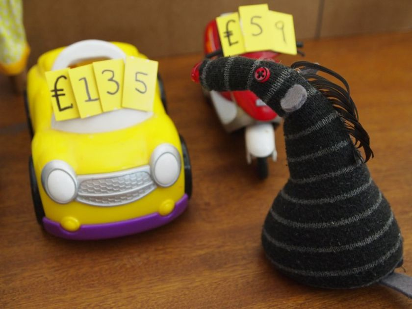 Bernard looks at a tiny yellow car priced at £135