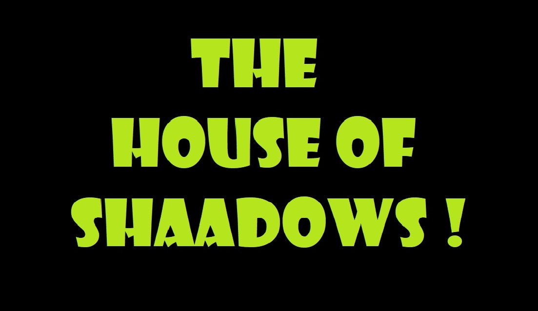 "Another black card reads ""The House of Shadows!"""