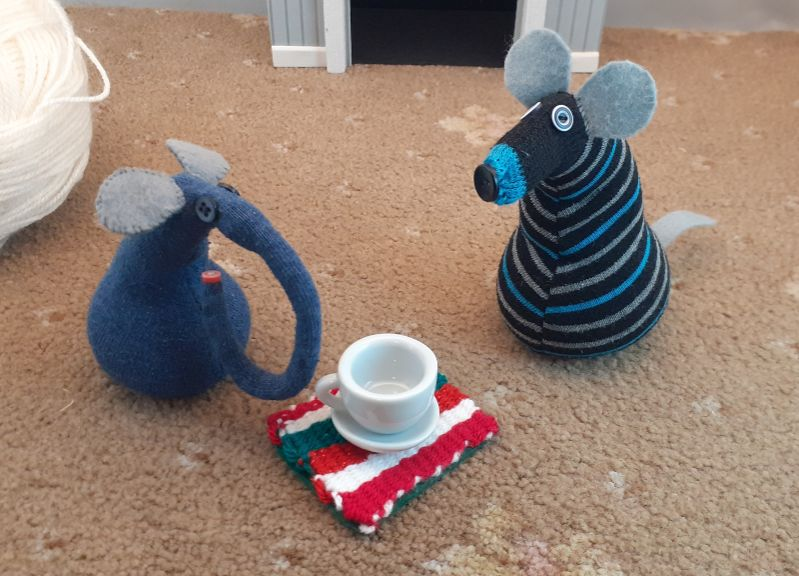 Ernest shows off the weaving as a coaster, with a cup and saucer on it.
