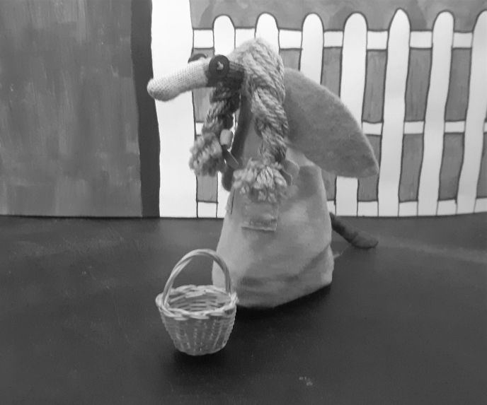 a sepia image of ofelia dressed as Dorothy in pinafore dress and carrying a basket