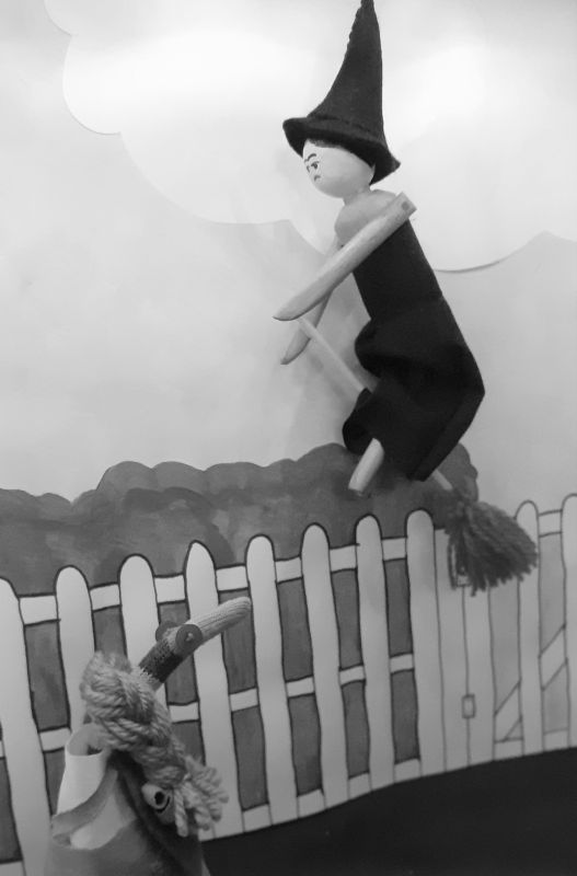 Miss gulch transforms into a witch on a broomstick