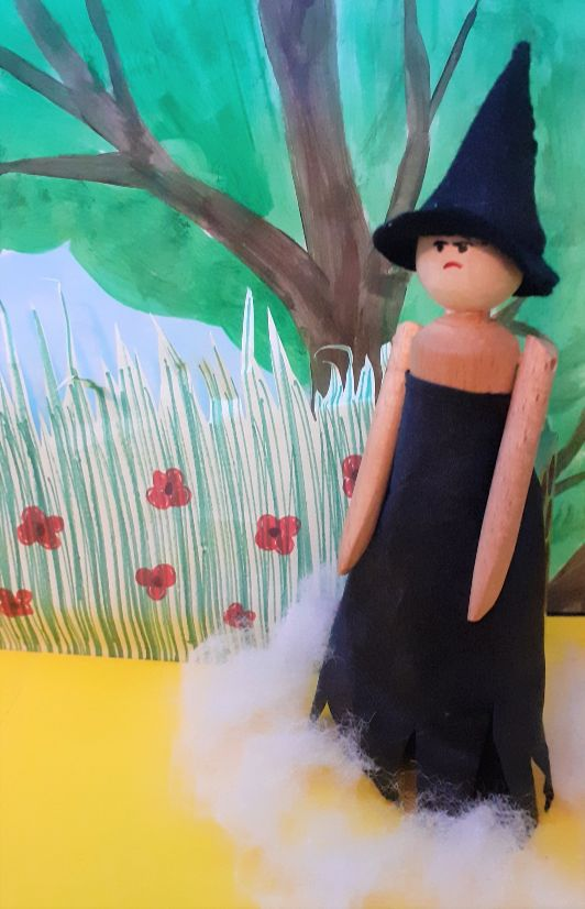 the witch appears in a field of poppies