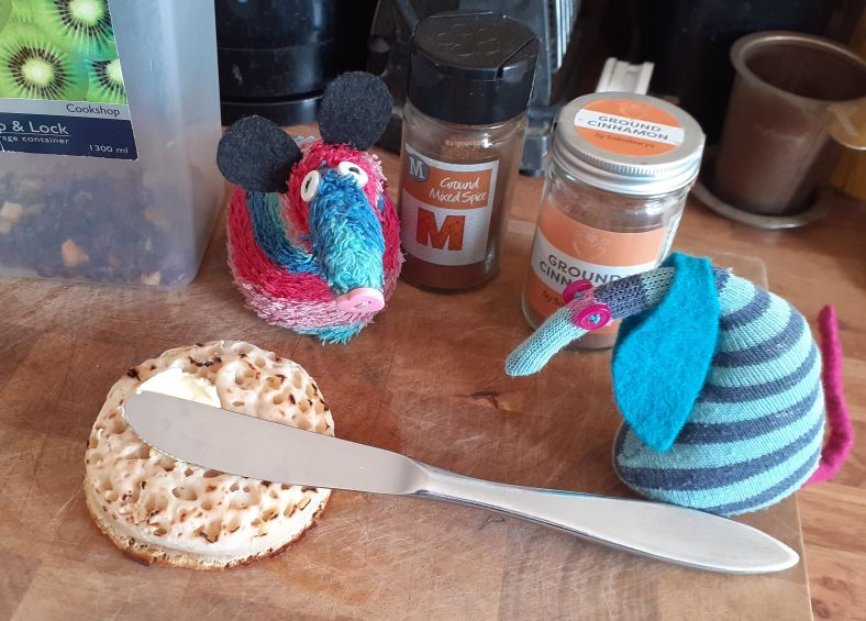 Ofelia spreads butter on the crumpet