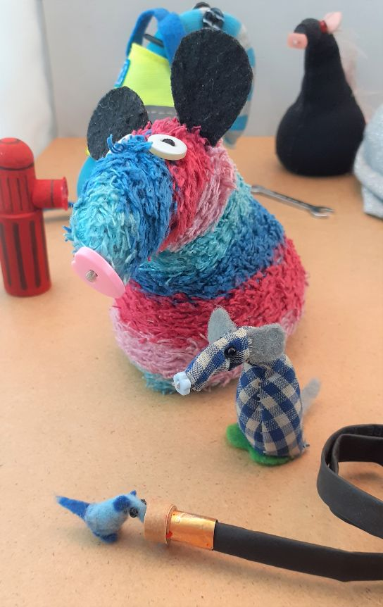 Ratvaark looks at Nano who is sticking his nose into the end of the hose