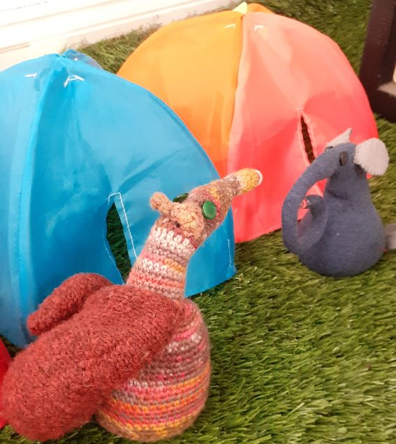 Esther talks to Ernest beside a pair of pop up tents