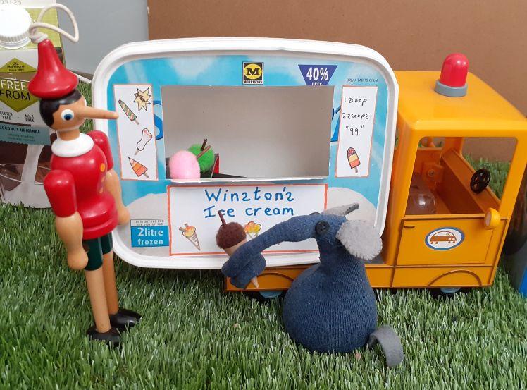 Ernest has an ice cream cone from the ice cream van