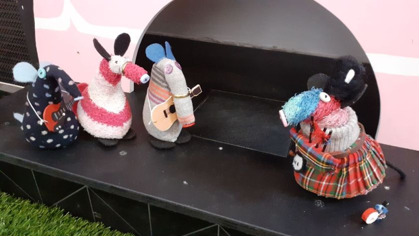 Ratvaark and Nano have come on stage in kilts and fur busby hats. Ratvaark has bagpipes and Nano has a tiny bass drum.
