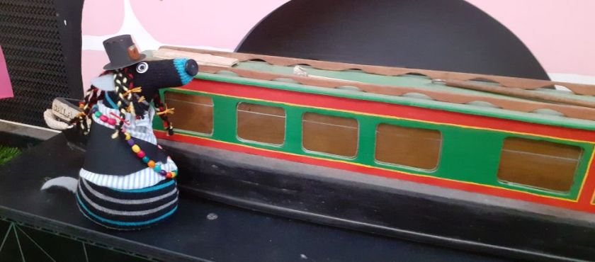 The boat, revealed as a narrowboat, fills the stage