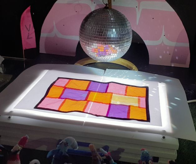 The whole dance floor is illuminated , with coloured panels.