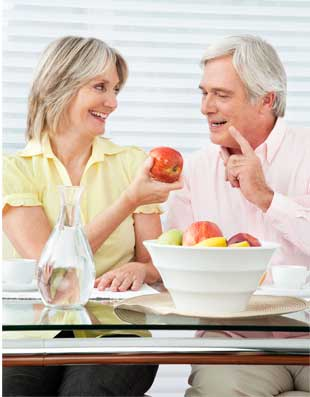 Mature couple eating with dentures