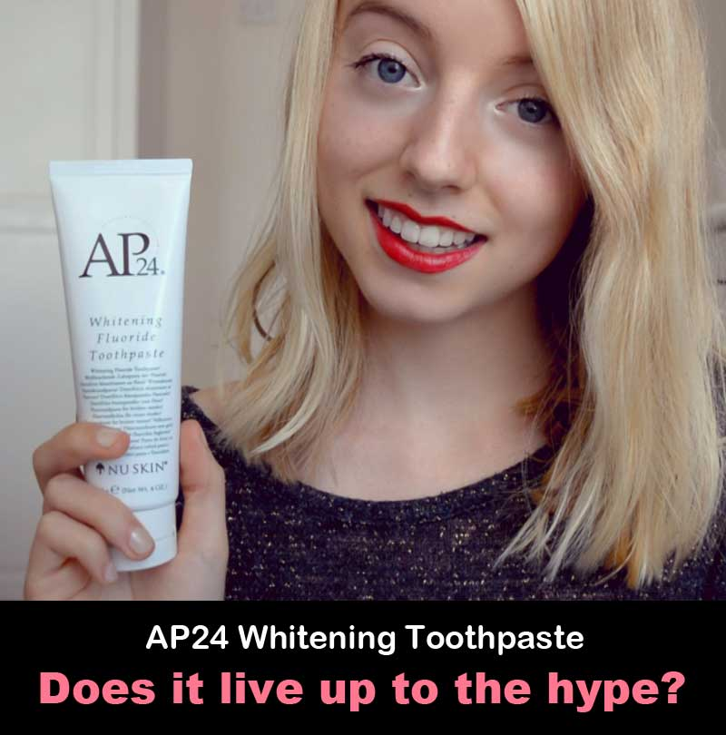 Photo of woman holding AP 24 Whitening fluoride toothpaste