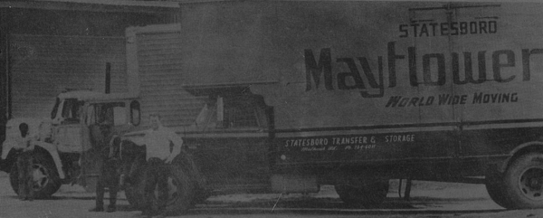 Founder Hal C. Waters poses with one of his trucks in the '70s.
