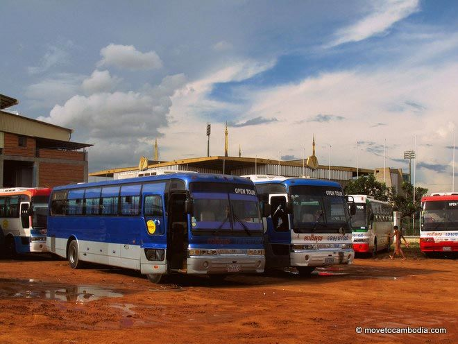 A couple of Cambodian buses parked in the bus yard, waiting to transport passengers.