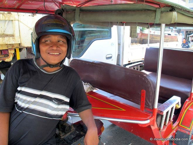 A tuk tuk driver in Cambodia giving a sidelong glance.