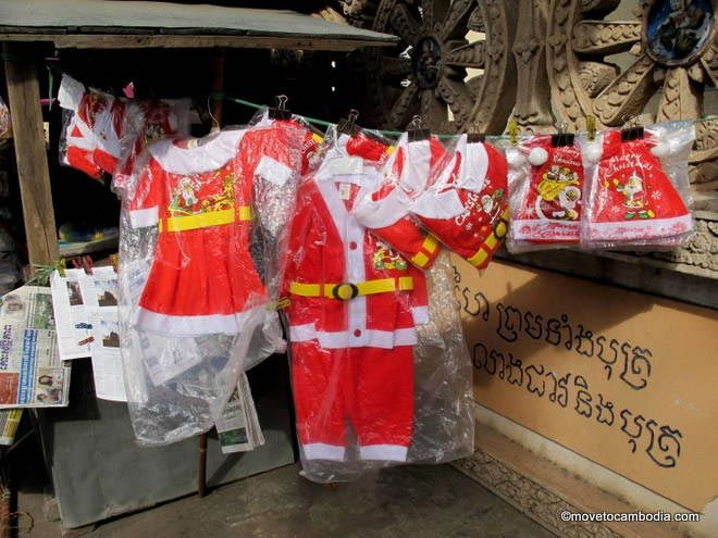 Toddler-sized Santa outfits in Cambodia.