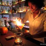 Hong Kry makes a drink with flair in a real tuk tuk at Siem Reap's Tuk Tuk Bar.