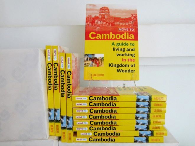 a stack of the Move to Cambodia paperbacks