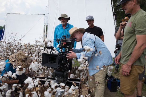 DP Elliot Davis (center) checks a shot in a cotton field