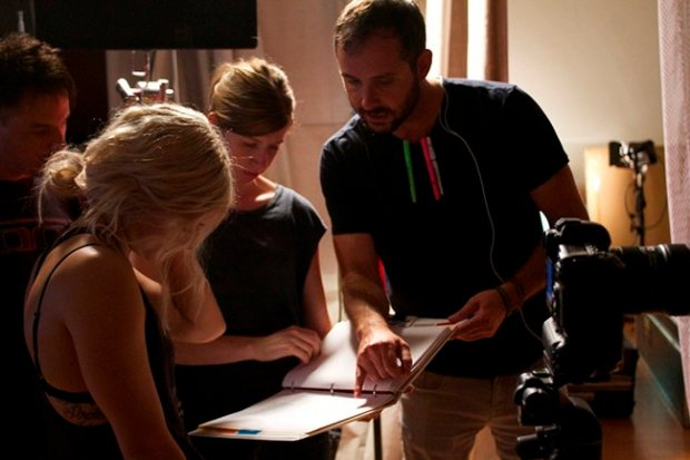 Evigan (left) and director Patrick Chapman (right) talk through a scene prior to rolling