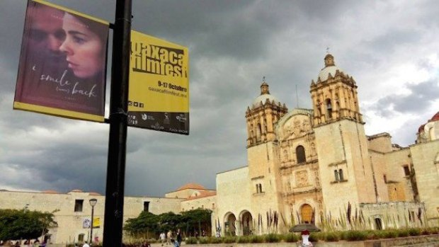 Festival signs in front of Santo Domingo Church. Photo by Douglas Favero.