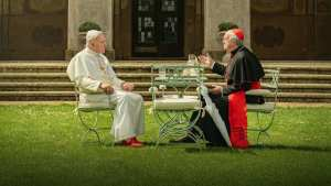 "The Two Popes (2019)<center><img class=""alignnone size-full wp-image-581"" src=""https://www.moviereviews.us/wp-content/uploads/2018/10/IMG_2353-7-1.jpg"" alt="""" width=""107"" height=""23"" /></center>"