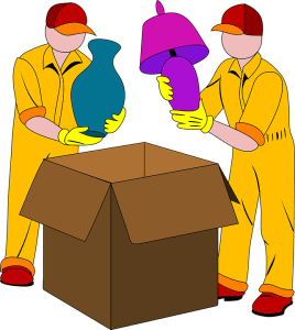 Two man packing things into a box