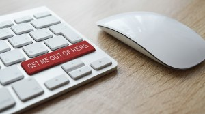 A red button on a white keyboard.