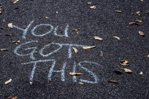 """You got this"" written in chalk on concrete."