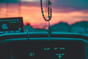 Rosary on a rearview mirror.