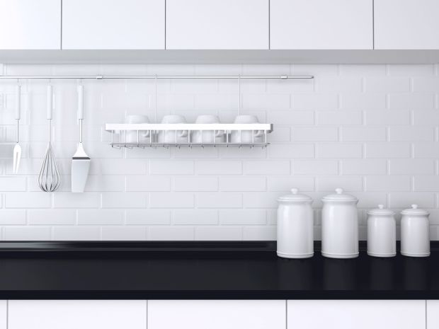 30528805 - utensils and kitchenware on the worktop. black and white kitchen design.