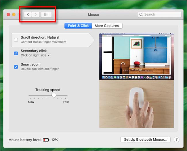 Boutons de navigation des préférences système sur Mac.